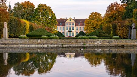 Abbots Palace in the rococo style and located in Oliwa Park in autumn scenery .. Gdansk, Poland.