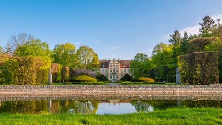 Abbots Palace in the rococo style and located in Oliwa Park in spring scenery.