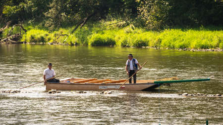 Szczawnica, Poland - September 11, 2020. Typical polish raftsmans on the Dunajec river. The rafting is very popular tourist attraction in Pieniny mountains.