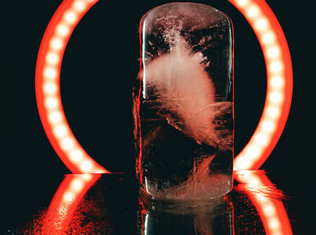 abstract photo of ice illuminated by red light in darkness