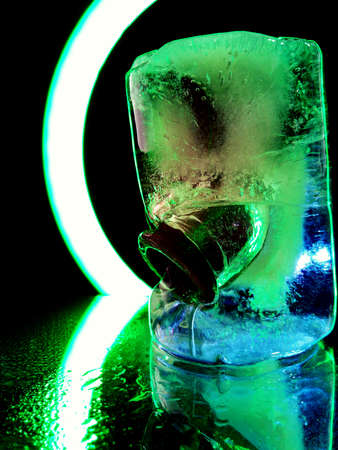 metal objects frozen in ice in creative and abstract macro photography
