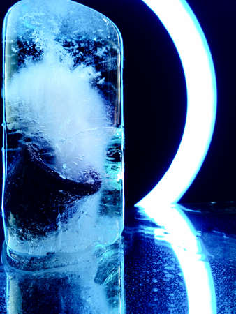 ice illuminated by blue light in the dark in abstract photography