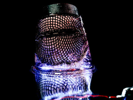 an abstract photograph of a microphone mesh frozen in ice that resembles a space fantasy Stock fotó