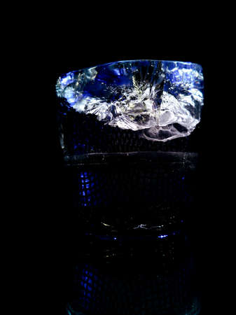 creative and abstract photo of a piece of ice with a mountain top Stock fotó
