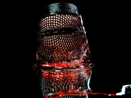 an abstract photograph of a black grid that symbolizes an upside-down shot of poison alcohol