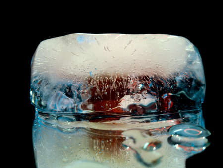 piece of ice glowing in the dark in abstract macro photography
