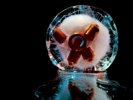 metal nozzles frozen in ice, glowing in ice in creative and abstract photography Stock fotó