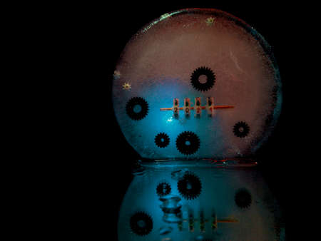 abstract and creative photo of gears frozen in ice and a counter showing the beginning of the new 2021 Stock fotó
