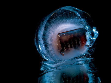 a creative photo of a counter in ice that symbolizes the coming of the new year 2021 Stock fotó