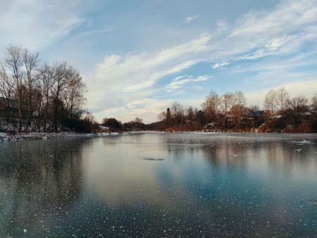 frozen snow covered lake surface against a blue sky with beautiful clouds Stock fotó