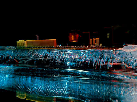 an abstract photograph of a wiring diagram frozen in ice like a night city