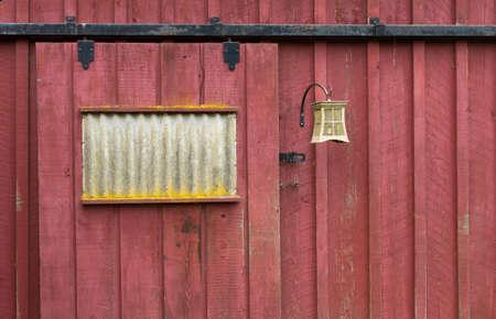 barndoor: Weathered Red Barn Door with Iron Fixtures Stock Photo
