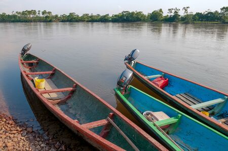 canoes with motor on the bank of the river in Colombia Stock Photo