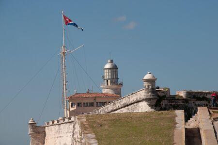 El Morro lighthouse with Cuban flag. Cuba Stock Photo
