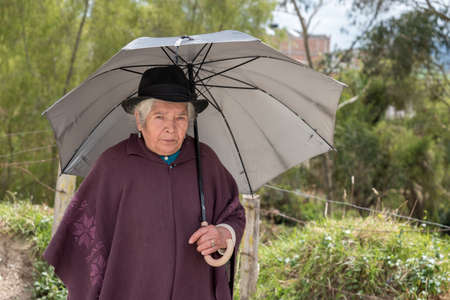 Elderly lady with typical clothes from the Boyaca area with typical dress of the place, where the sowing of potatoes predominate. January 25, 2018 Editorial