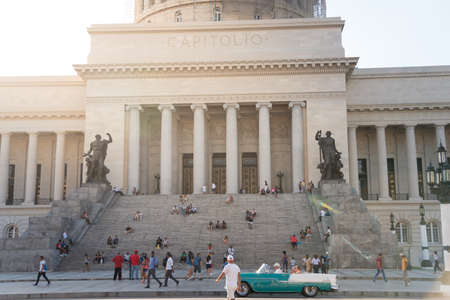 Staircase at the entrance to the facade of the Capitol of Havana where students and pedestrians sit to rest. Havana Cuba. February 2, 2019 写真素材 - 150565288