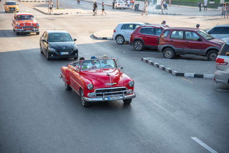 Classic convertible car on a tour through the streets of Havana. A very common activity in Old Havana. Havana.Cuba January 2, 2019.