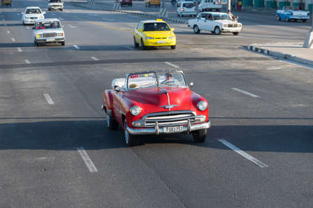 Classic convertible taxi in the streets of Havana used to transport tourists through the historic area of Old Havana.Habana. Cuba. January 2, 2019 Editorial