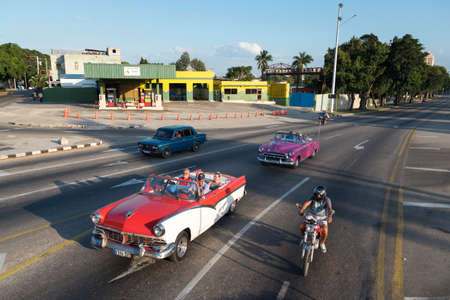 Tourist tour in a classic convertible car in Vedado, a residential district of the city where you can find great constructions from the 30s and 40s. Havana. Cuba. January 2, 2019 写真素材 - 150569574