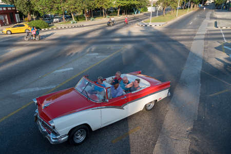 Classic convertible taxi in the streets of Havana used to transport tourists through the historic area of Old Havana.Habana. Cuba. January 2, 2019 写真素材 - 150569575