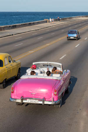 Classical convertible taxi in Malecon Avenue in Havana, this type of transportation has become an attraction for tourists visiting the island. Havana. Cuba February 2, 2019. 写真素材 - 150569585