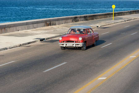 Classical convertible taxi in Malecon Avenue in Havana, this type of transportation has become an attraction for tourists visiting the island. Havana. Cuba February 2, 2019.