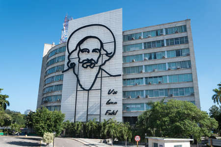 Ministry of Communications with image of Camilo Cienfuegos one of the most important heroes of the Cuban revolution. Havana. Cuba. January 2, 2017