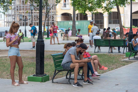 Park where people of all ages meet to find wi fi in the old havana. Havana Cuba. January 2, 2019. 写真素材 - 150565455