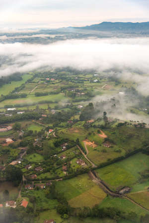 Aerial view of country houses in Colombian landscape