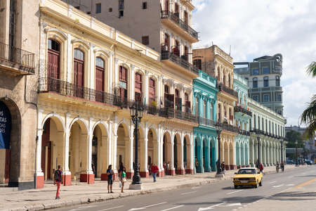 Avenue with colorful colonial facades in old Havana with the movement of people in daily activity. Havana. Cuba.January 10, 2020.