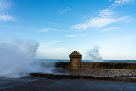 wave breaking against the wall of the malecon in havana Stock Photo