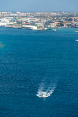 Yacht sport fishing away from the coast of the port of Oranjestad. Aruba Netherlands Antilles 写真素材