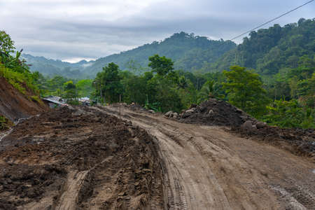 Rural clay road in very difficult access conditions for transportation in the area. Colombia. 写真素材