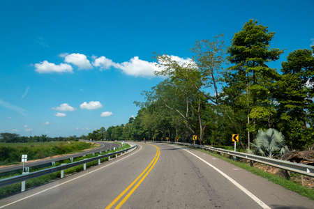 curve of a Colombian road in a tropical climate zone 写真素材