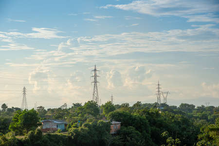 High voltage electricity towers in a Colombian country landscape. 写真素材
