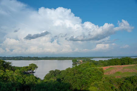 Country landscape of lagoon between lush trees in Colombia 写真素材