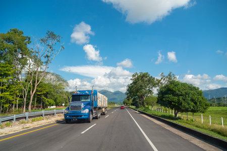 Truck loading merchandise on a Colombian highway Standard-Bild
