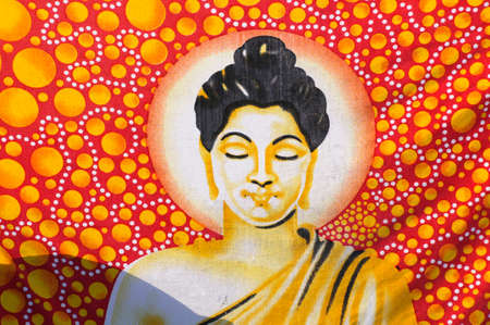 Portrait of Buddha with red and golden elements