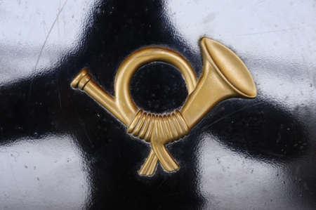 golden post horn on black background Stock Photo