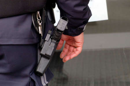 Police officer armed with handgun