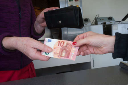 Cash transaction with euro banknote Stock Photo