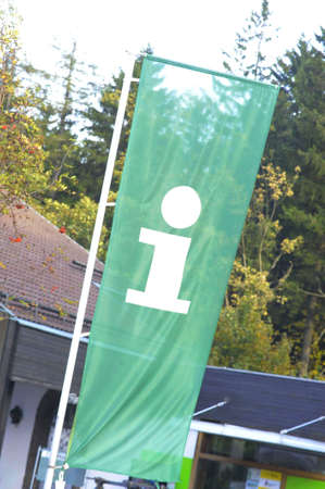 A green tourist information flag