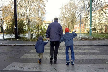 Children with parent on zebra crossing