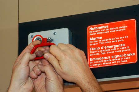 Three hands pulling emergency signal brake 写真素材