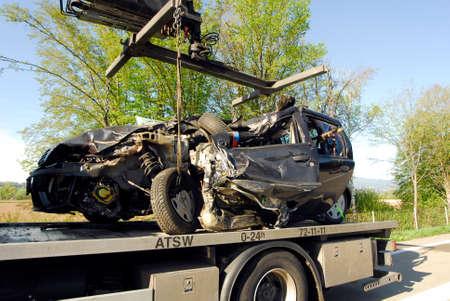 Crashed car transportation on a truck Imagens