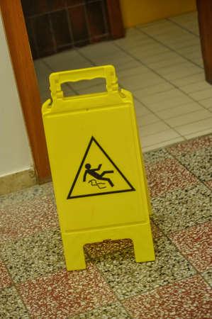 Yellow slippery floor sign, indoors