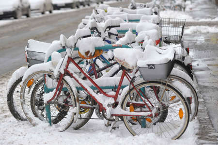 Snow covered bicycles in winter