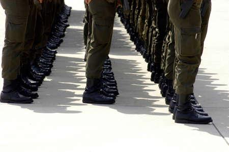 Soldiers standing still in line Standard-Bild