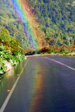 end of on rainbow on road