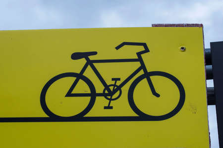 yellow bicycle sign, cycle path
